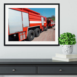 Red fire engine standing on the road Framed Print - Canvas Art Rocks - 1