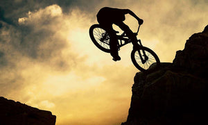 Silhouette of a man on muontain-bike Wall Mural Wallpaper - Canvas Art Rocks - 1