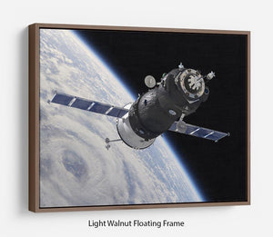 Spaceship Soyuz TMA at the Earth orbit Floating Frame Canvas