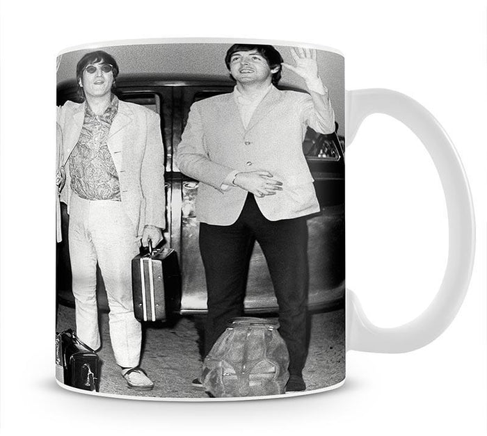 The Beatles and Brian Epstein at London Airport Mug