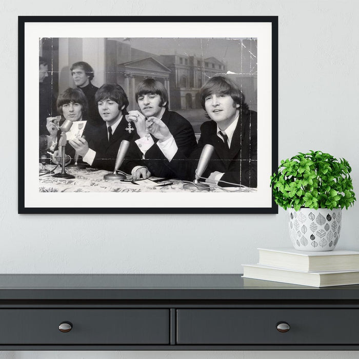 The Beatles at a press conference with their MBEs Framed Print
