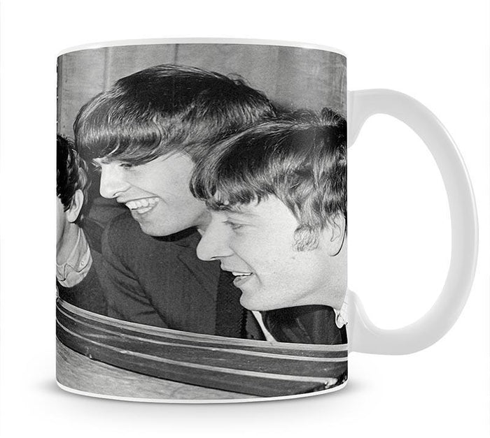The Beatles play with toy racing cars Mug