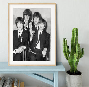 The Beatles sitting with their MBEs Framed Print - Canvas Art Rocks - 3