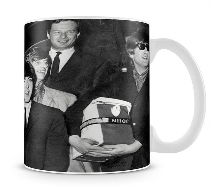 The Beatles with Brian Epstein at London Airport Mug