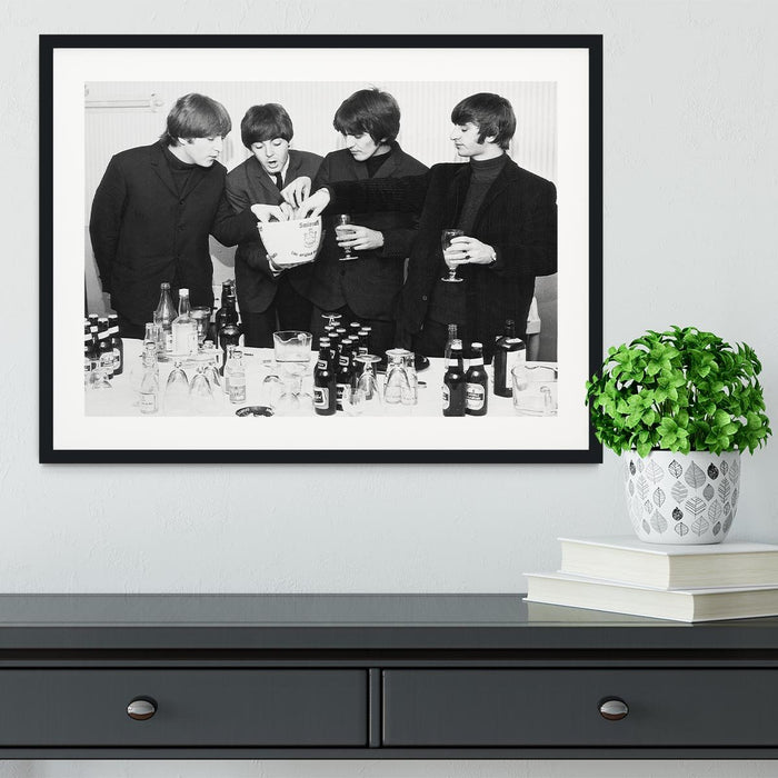 The Beatles with bottles of beer Framed Print