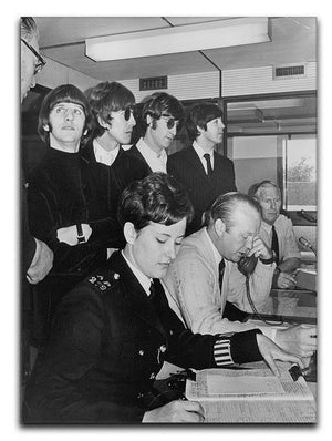 The Beatles with police at London Airport Canvas Print or Poster  - Canvas Art Rocks - 1