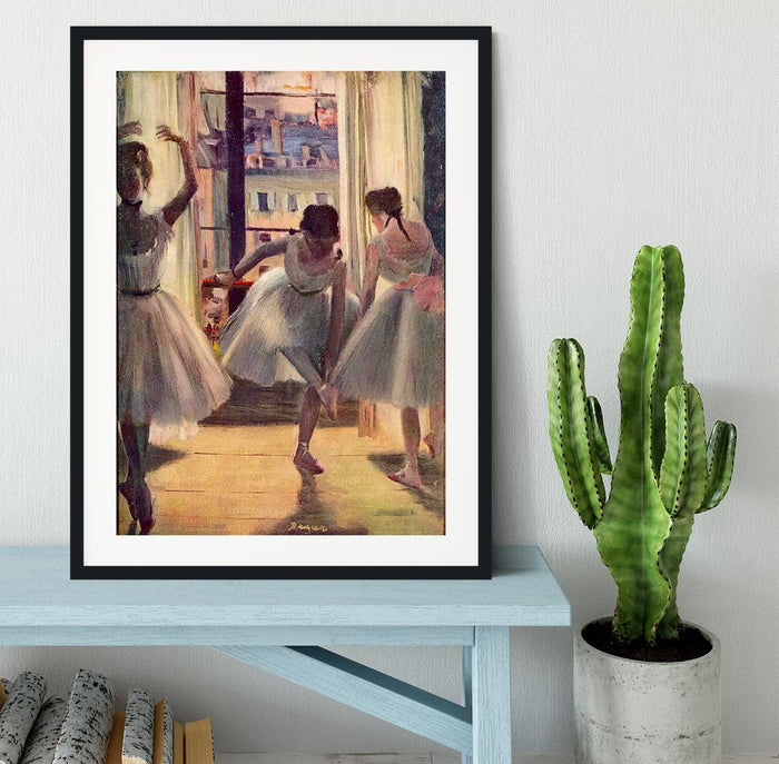 Three dancers in a practice room by Degas Framed Print