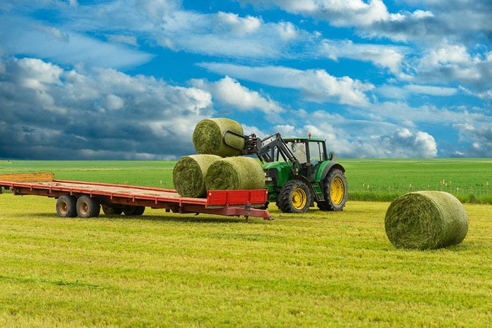 Tractor and trailer with hay bales Wall Mural Wallpaper