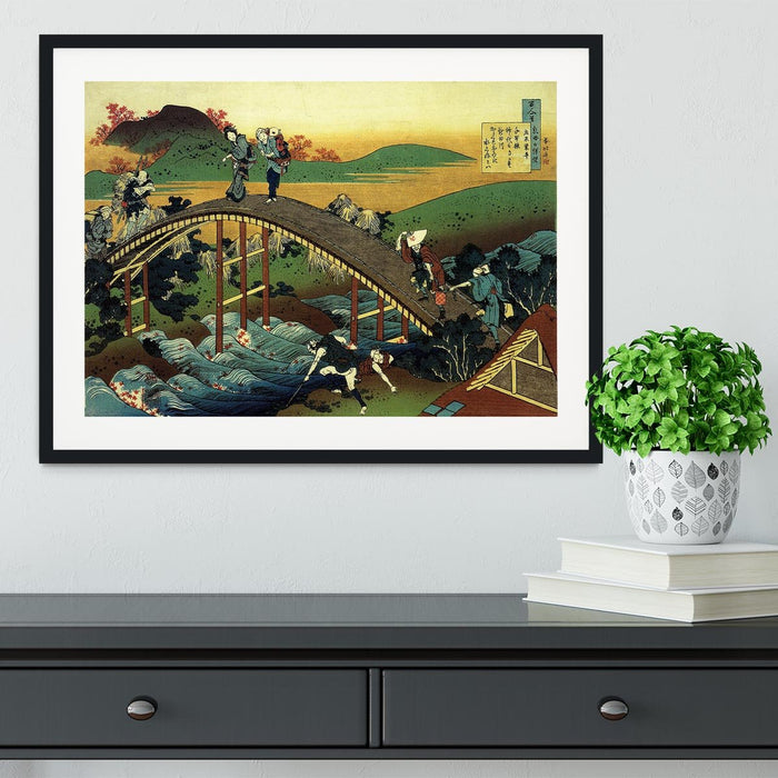Travellers on the bridge near the waterfall of Ono by Hokusai Framed Print