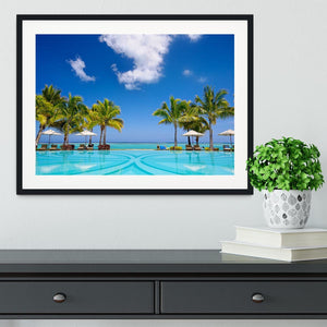 Tropical beach resort with lounge chairs Framed Print - Canvas Art Rocks - 1