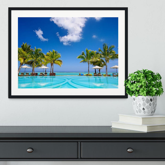 Tropical beach resort with lounge chairs Framed Print