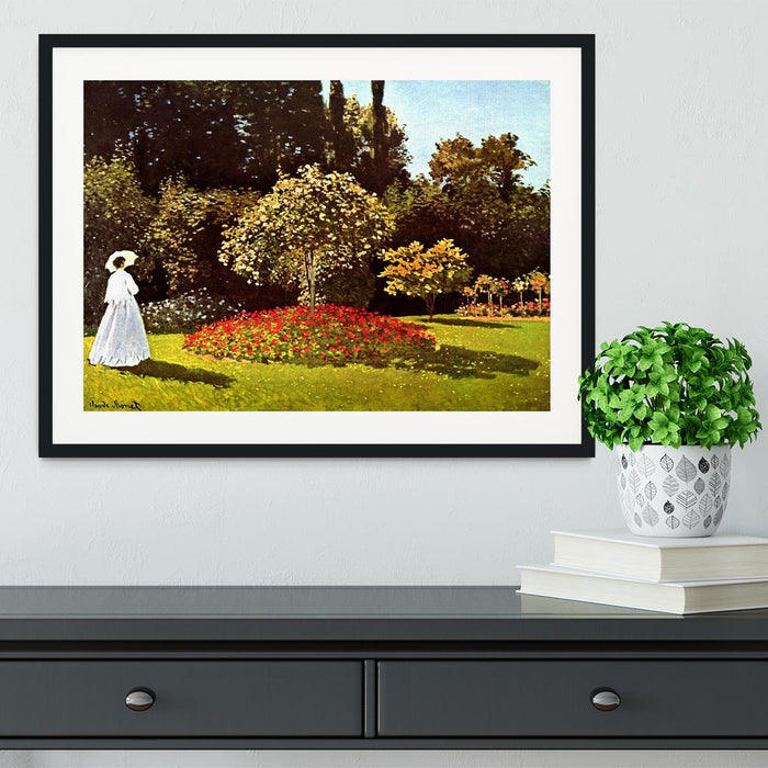 Woman in the garden by Monet Framed Print