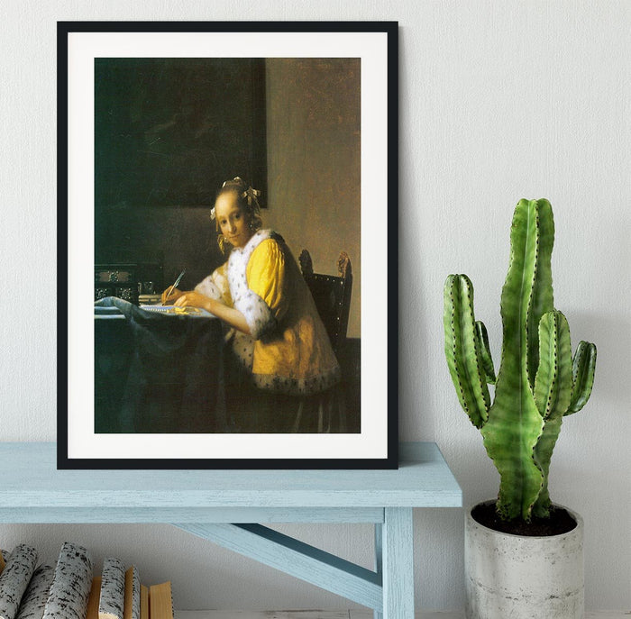 Woman in yellow by Vermeer Framed Print