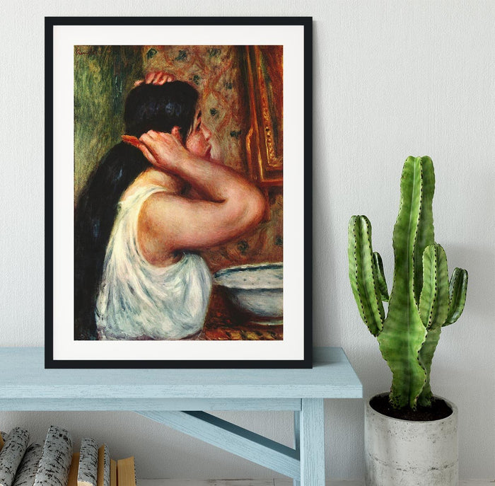 Woman with hair combs by Renoir Framed Print