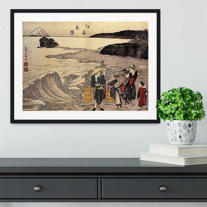 Women on the beach of Enoshima by Hokusai Framed Print
