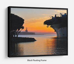 aircraft carrier in harbour in sunset Floating Frame Canvas