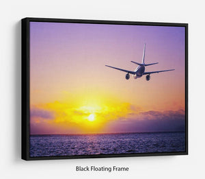 airplane in the sky over ocean Floating Frame Canvas