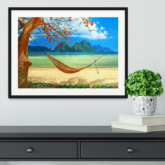 tropical beach scene with hammock Framed Print