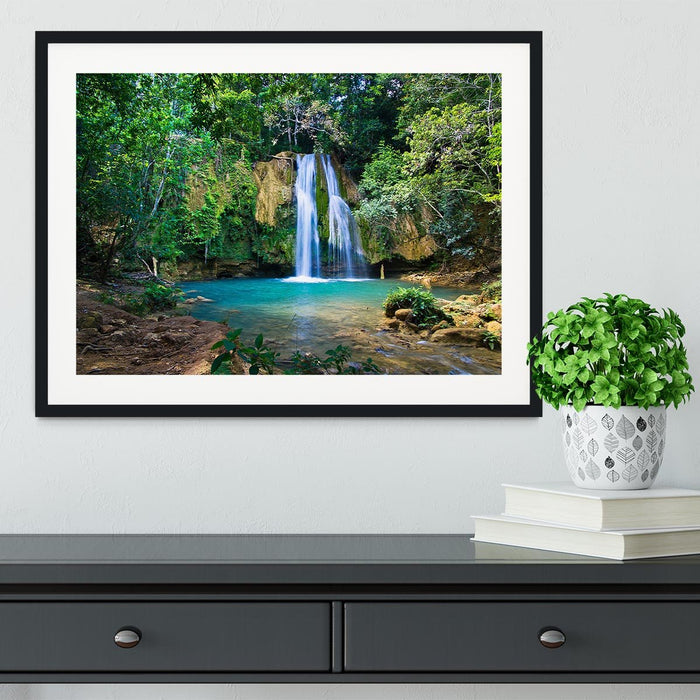 waterfall in deep green forest Framed Print