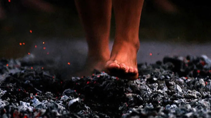 Walking bare foot on hot ashes and coal