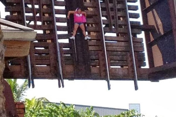 Woman in pink top stuck on lifting railroad