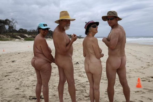 Two couples naked on a nudist beach