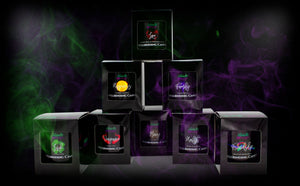 Naturally Wicked Spellbinding Candles On Dark Background With Purple & Green Smoke