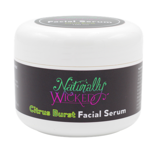 Naturally Wicked Citrus Burst Protective Facial Serum On Black Background