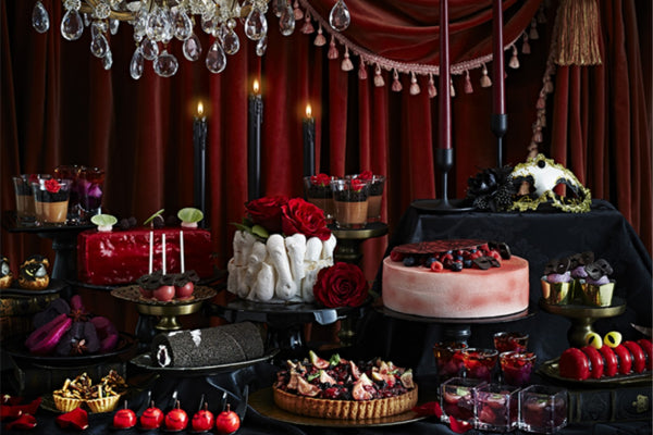 Luxury Halloween Buffet With Feast Of Cakes, Red Roses, Black Candles On Spooky Setting