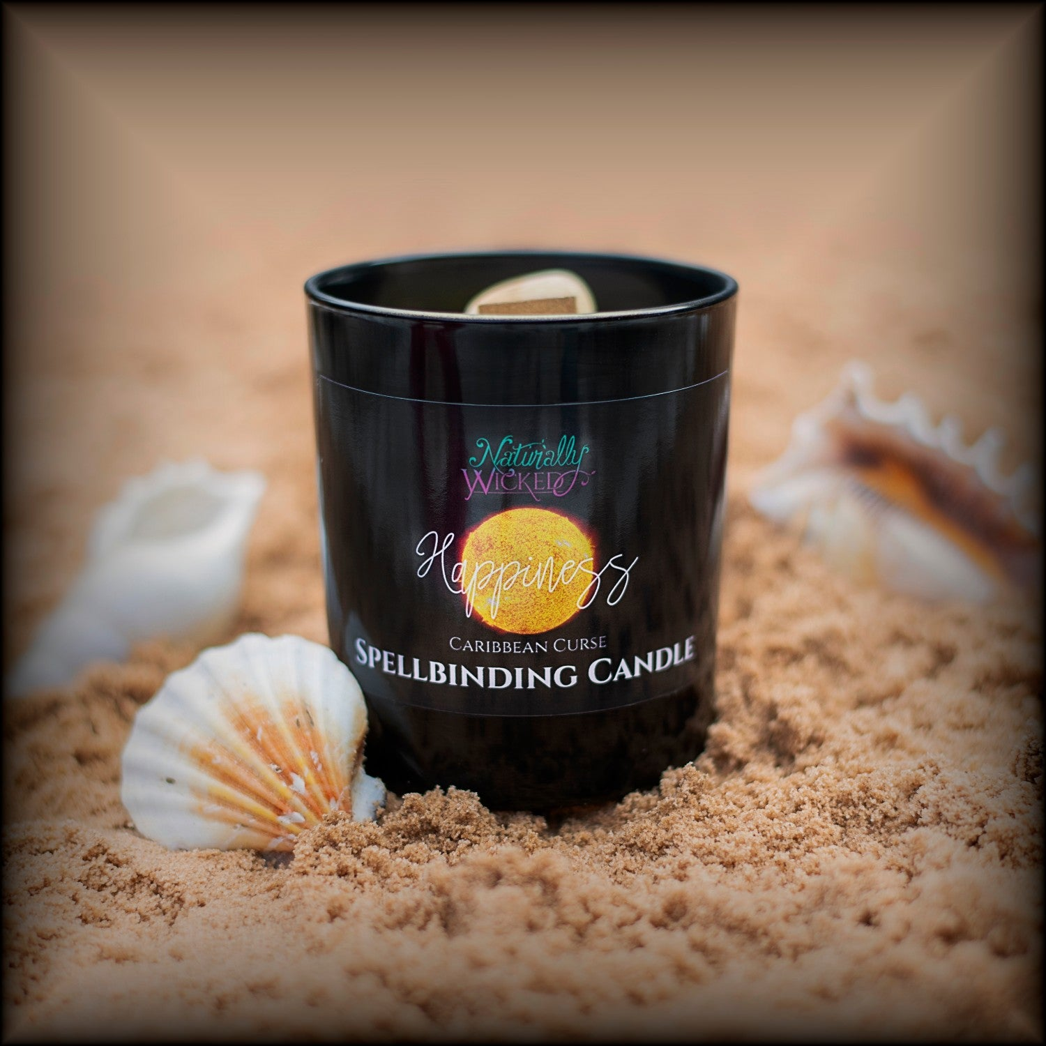 Naturally Wicked Spellbinding Happiness Candle Entombed With Bright Yellow Citrine Crystal Sits On Bright Beach Surrounded By Shells