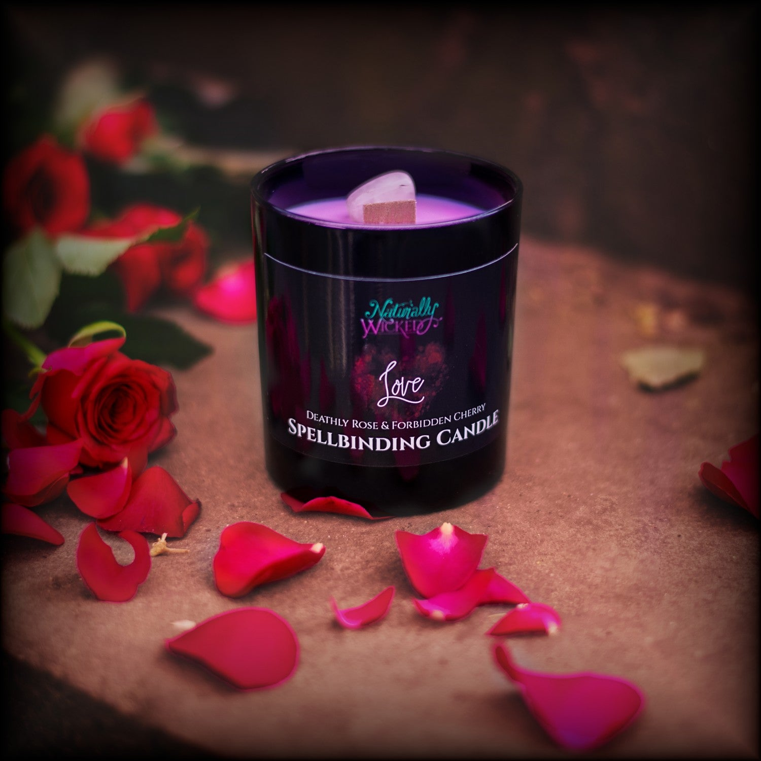 Naturally Wicked Spellbinding Love Candle Entombed With Bright Pink Quartz Crystal Sits On Romantic Steps Drizzled In Red Rose Petals