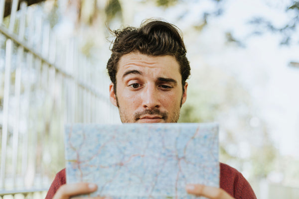 Man With Map Looking Confused - Naturally Wicked