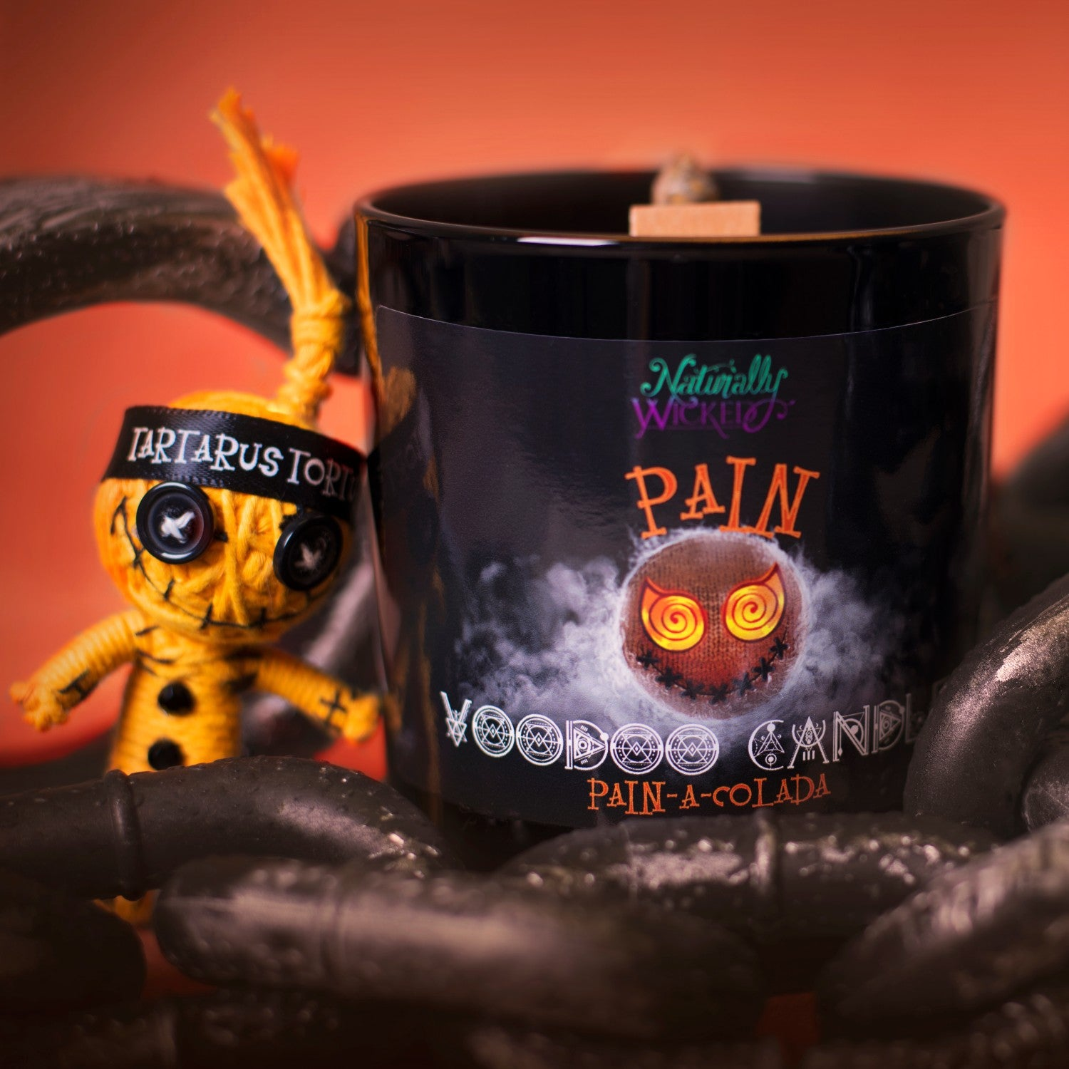 Naturally Wicked Voodoo Pain Spell Candle Amongst Torture Chains & Orange Voodoo Pain Doll