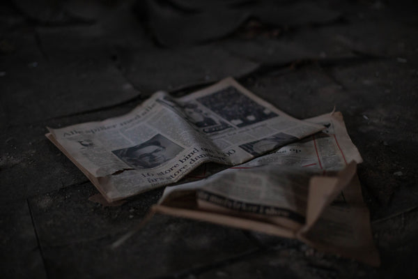 Old Newspapers On The Floor - Naturally Wicked