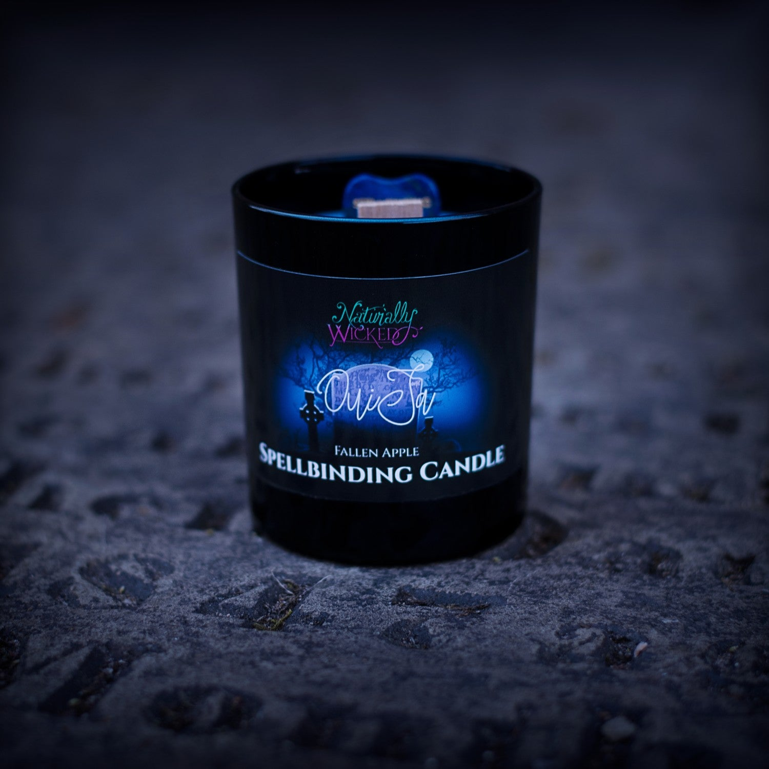 Naturally Wicked Spellbinding Ouija Candle Entombed With Sodalite Crystal Ouija Planchette Sits on Dark Gravestone