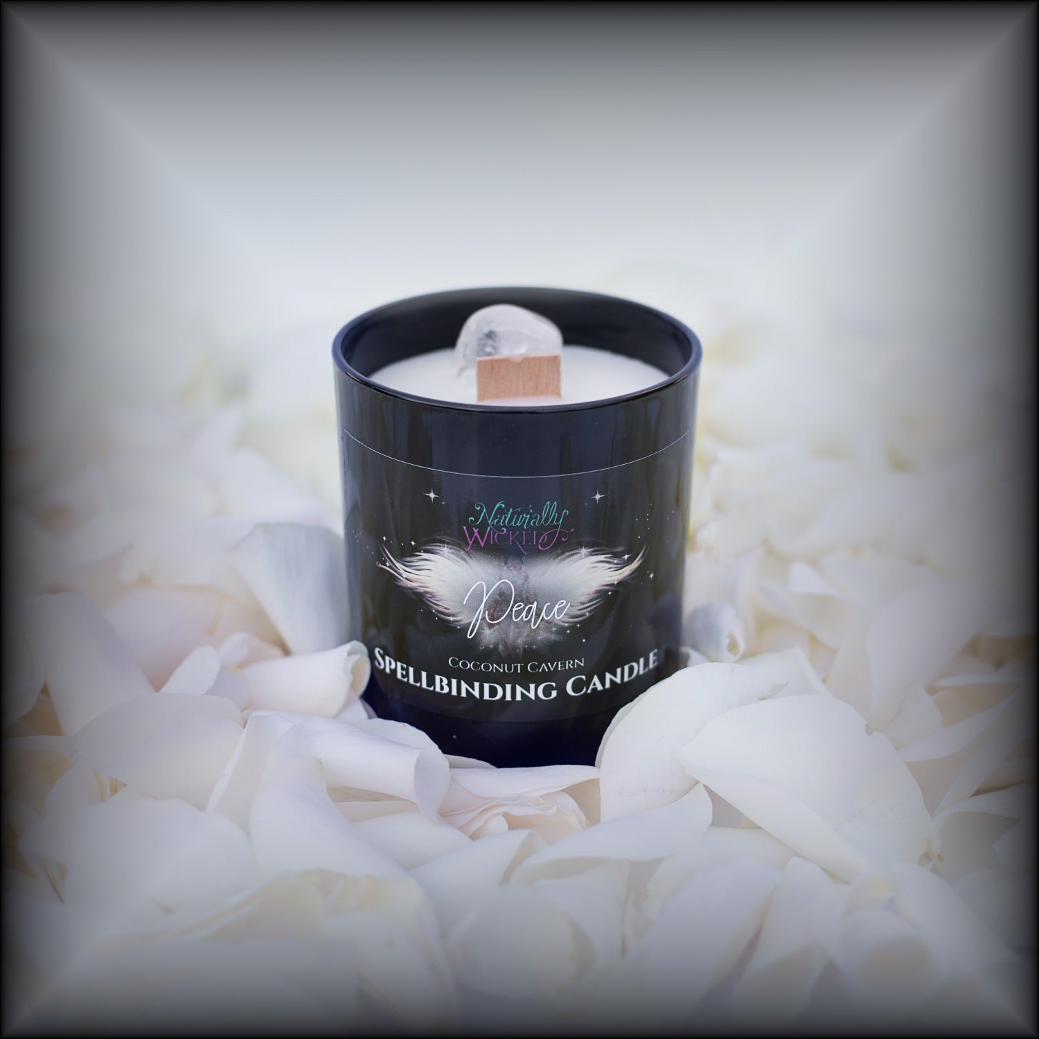 Naturally Wicked Spellbinding Peace Candle Entombed With Quartz Crystal Sits Amongst White Petals