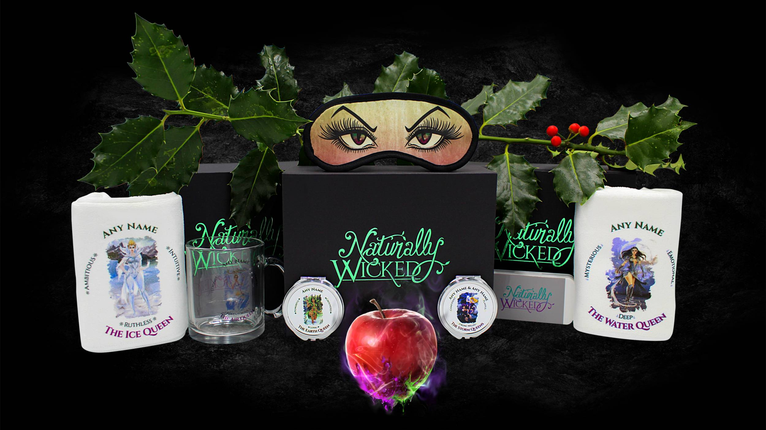 Naturally Wicked Black & Green Personalised Deluxe Gift Boxes Surrounded By Eye Mask, Wicked Queen Towels, Mirrors, Mug & Poisonous Apple
