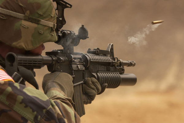 Soldier Firing Round From American Army Rifle