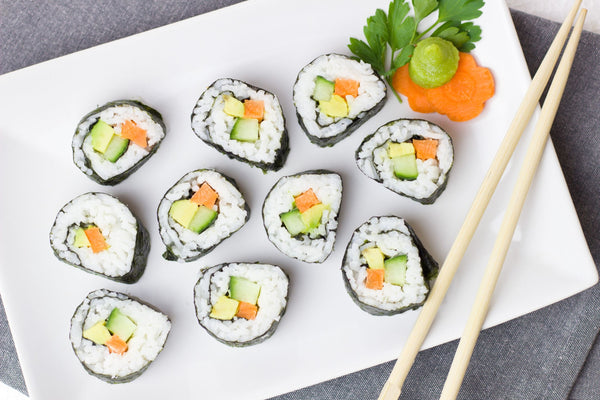 Delicious sushi and vegetable rice rolls - vegan