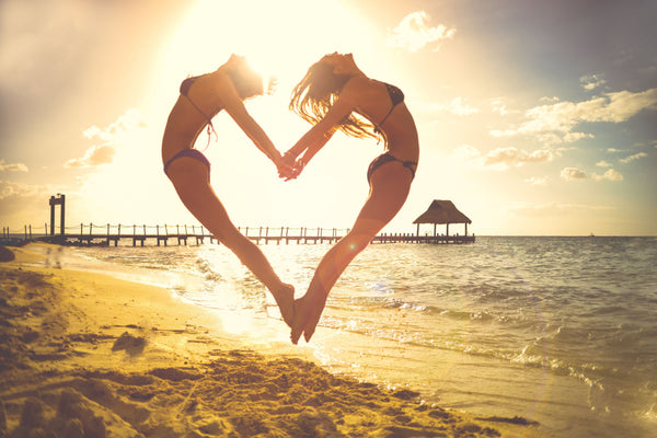 Women With love Heart on the beach