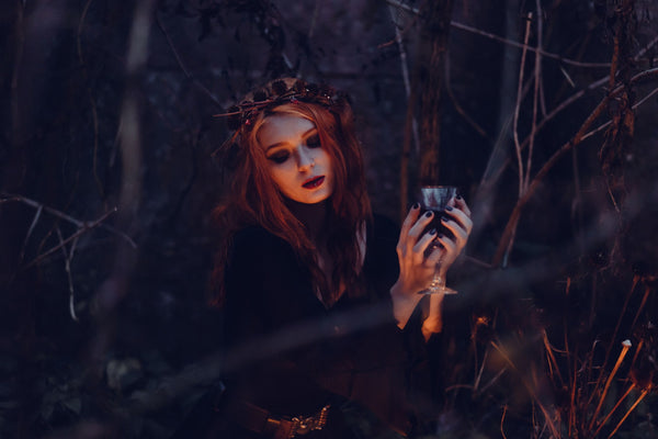 Beautiful Ginger Witch Woman in the dark