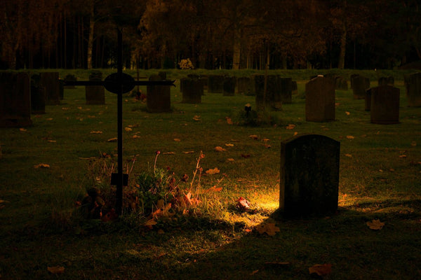 Dimly Lit Graves At Night - Naturally Wicked