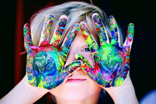 messy paint on childs hands