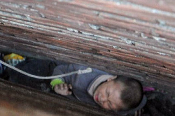 Man stuck in wall cavity