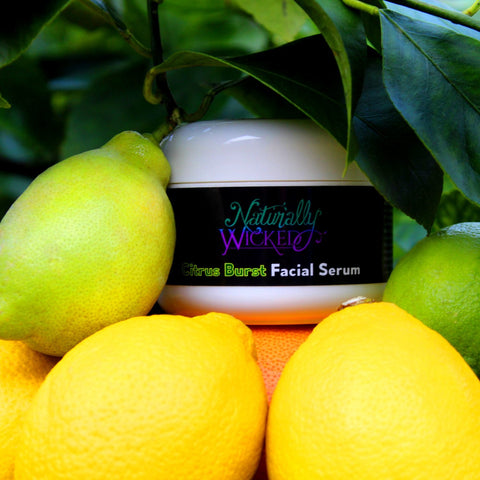 Naturally Wicked Citrus Burst Facial Serum Surrounded By Lemons & Limes Outdoors