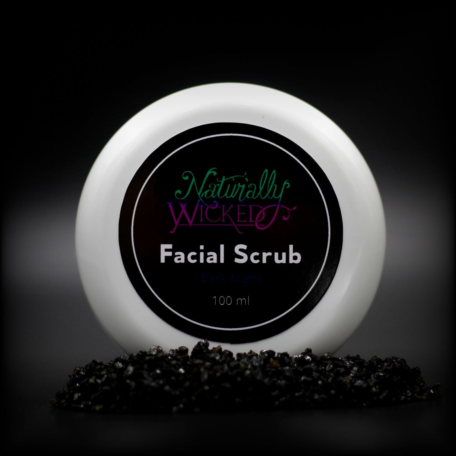 Naturally Wicked Dark Night Facial Scrub Lid Surrounded By Exfoliating Activated Charcoal