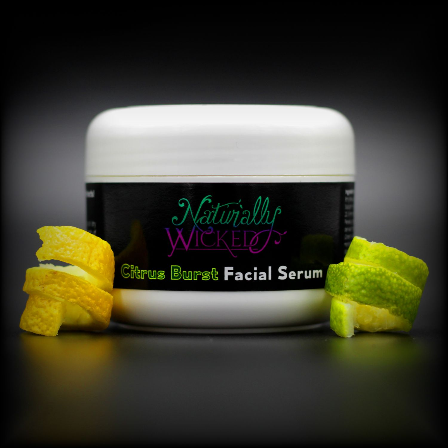 Naturally Wicked Citrus Burst Facial Serum With Sliced Yellow Lemon Twist & Sliced Green Lime Twist Either Side