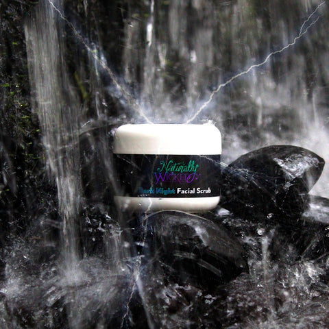 Naturally Wicked Dark Night Facial Scrub Surrounded By Charcoal In Waterfall With Electrical Charge