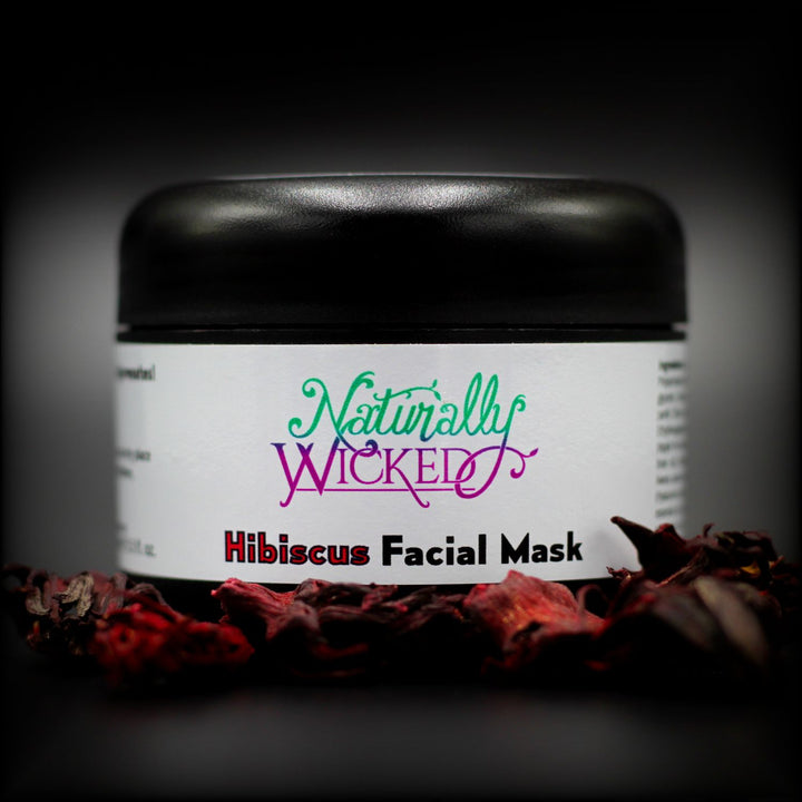 Naturally Wicked Hibiscus & Vanilla Facial Mask Behind Bright Red Dried Hibiscus Flowers  - Step 2