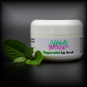 Naturally Wicked Peppermint Lip Scrub Beside Bright Green Peppermint Leaves
